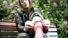 Flirtatious Fishnet Footshow In Public