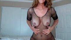 Milf Teases You In A Seductive Fishnet Outfit